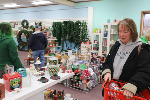 AIMEE AMBROSE   THE GOSHEN NEWS  Jantha Corp, Elkhart, shops for glassware she can use to make Christmas gifts at The Depot Thrift Shops in Goshen during the Small Business Saturday event on Saturday.