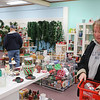 AIMEE AMBROSE | THE GOSHEN NEWS  Jantha Corp, Elkhart, shops for glassware she can use to make Christmas gifts at The Depot Thrift Shops in Goshen during the Small Business Saturday event on Saturday.
