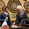 BEN MIKESELL | THE GOSHEN NEWS<br /> Melody Norton, of Orland, right, flips through mats while shopping for Wana Night Out with her daughter Tia Everidge at Truly Yours inside Davis Mercantile in Shipshewana. In tune with the city-wide shopping event, Truly Yours offered 25 percent off purchases for the whole day.
