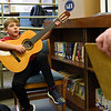 BEN MIKESELL | THE GOSHEN NEWS<br /> Third-grader Keller Wesdorp plays a guitar during science fair judging Thursday morning at Ox Bow Elementary School. Wesdorp's science project was an experiment on how holding a guitar in different positions can affect volume.