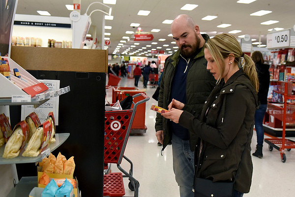 BEN MIKESELL | THE GOSHEN NEWS<br /> Rachelle Judd and her husband Matt, of Middlebury, go shopping through Target on Black Friday, looking for presents for nieces and nephews.