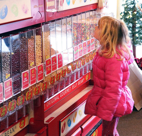 SHEILA SELMAN | THE GOSHEN NEWS<br /> Kera Oyer, Goshen, looks at a wall of candy at The Nut Shoppe in downtown Goshen during Shop Small Business Saturday.