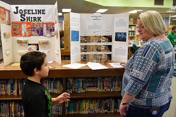 BEN MIKESELL | THE GOSHEN NEWS<br /> Third-grader Dominic Moya, left, explains his science experiment to judge Jennifer Davis, Concord School Board member, Thursday morning at Ox Bow Elementary School.