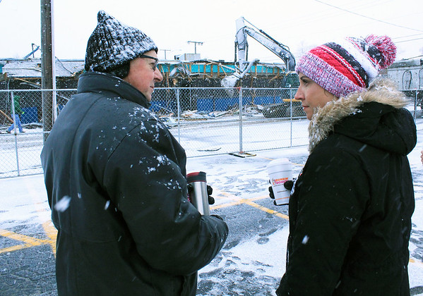Roger Schneider | The Goshen News<br /> Denny Yoder, who once owned the The Oasis bar and restaurant in Goshen with his wife Mary, talks with current co-owner Heather Tobias Harren. The bar is being torn down so it can be rebuilt in 2019.