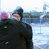 Roger Schneider | The Goshen News<br /> Denny Yoder, former owner of The Oasis, hugs current co-owner Heather Tobias Harren Monday morning. Harren said earlier this year her first job at the age of 12 was  washing dishes at the restaurant/bar. In the bakground a backhoe operator begins tearing down The Oasis.