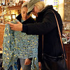 SHEILA SELMAN | THE GOSHEN NEWS<br /> After their children left to go back home after Thanksgiving, mothers in law Diane Chesna, Warsaw, left, and Rita McCarthy, Tucson, Arizona, hit the shops in downtown Goshen, including this excursion into Found. Here they are looking at scarves.