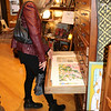 SHEILA SELMAN | THE GOSHEN NEWS<br /> Glenda Koshmider, Goshen, looks at prints at Found in downtown Goshen during Shop Small Business Saturday.