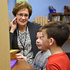 BEN MIKESELL | THE GOSHEN NEWS<br /> Volunteer judge Sherry Sumrak asks questions to third-graders Eli McKeown and Tyler Golden about their science fair project Thursday morning at Ox Bow Elementary School. McKeown and Golden's project involved measuring electricity in fruits and vegetables.