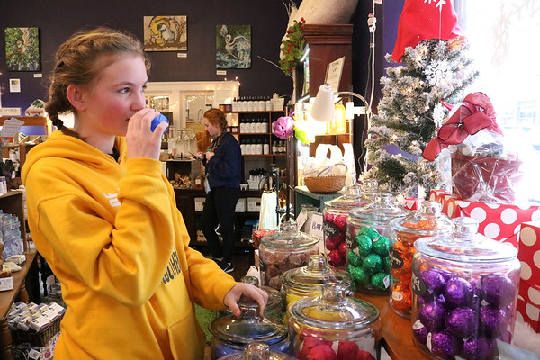 SHEILA SELMAN   THE GOSHEN NEWS<br /> Elisha Miller, Wichita, Kansas, smells one of the bath fizzes at The Soapy Gnome Saturday in downtown Goshen during Shop Small Business Saturday.