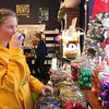 SHEILA SELMAN | THE GOSHEN NEWS<br /> Elisha Miller, Wichita, Kansas, smells one of the bath fizzes at The Soapy Gnome Saturday in downtown Goshen during Shop Small Business Saturday.