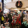 SHEILA SELMAN | THE GOSHEN NEWS<br /> Shoppers mill around and make purchases at The Soapy Gnome during Small Business Saturday in downtown Goshen.