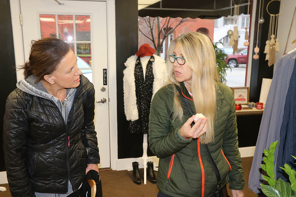 AIMEE AMBROSE | THE GOSHEN NEWS <br /> (from left) Toni English, North Webster, and Cindy Curtis, Syracuse, browse merchandise at Elysian Co. in downtown Goshen during the annual Small Business Saturday event.