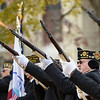 BEN MIKESELL | THE GOSHEN NEWS<br /> Veteran Mike Wheeler, of Goshen, fires his rifle in the three-volley salute during the Veterans Day ceremony Monday morning outside the Elkhart County Courthouse in Goshen.
