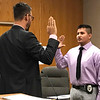 JOHN KLINE | THE GOSHEN NEWS<br /> Goshen Mayor Jeremy Stutsman, left, conducts the swearing-in ceremony for Antonio Medina-Leyva following his hiring as a probationary patrol officer with the Goshen Police Department during Tuesday's Board of Public Works and Safety meeting.