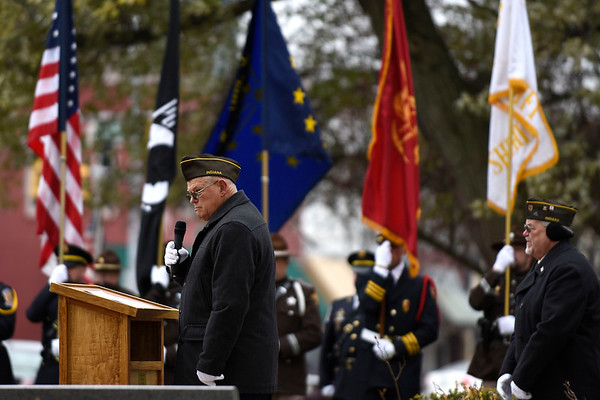 BEN MIKESELL | THE GOSHEN NEWS<br /> Vietnam veteran John Alheim, of Goshen, speaks during Monday morning's Veterans Day ceremony outside the Elkhart County Courthouse. Alheim, now the commander of the Goshen's Veterans of Fereign Wars Post 985, spent one year in Vietnam during his service in the military.