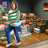 BEN MIKESELL | THE GOSHEN NEWS<br /> Erika Riegsecker, Operation Christmas Child committee member, packs up shoeboxes Tuesday that have been delivered this week at Clinton Frame Church on C.R. 35. Volunteers at the church are accepting donations for the Operation Christmas Child until next Monday, which will then be sent to Niles, Michigan, and distributed across the world.