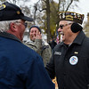 BEN MIKESELL | THE GOSHEN NEWS<br /> Veteran Charlie Stacy, part of the honor guard, greets folks after the Veterans Day ceremony Monday morning outside the Elkhart County Courthouse in Goshen. Stacy is an Army veteran who served in the Korean War.
