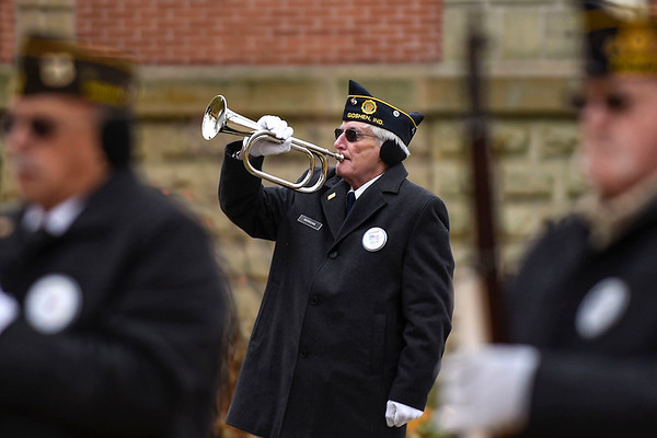 BEN MIKESELL | THE GOSHEN NEWS<br /> Vietnam veteran Terry Morgan, of Goshen, plays the bugle during the Veterans Day ceremony Monday morning on the Elkhart County Courthouse lawn in Goshen.