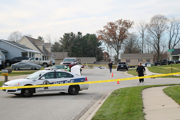AIMEE AMBROSE | THE GOSHEN NEWS <br /> Crime scene tape blocks an area of Alfalfa Street at Bermuda Court as Goshen police investigate an apparent shooting Wednesday afternoon.