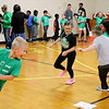 AIMEE AMBROSE | THE GOSHEN NEWS <br /> South Side Elementary School students run the ring-around-the-rosie portion of an obstacle course set up in the gym Friday as part of the school's annual Read, Write, Move fundraiser.