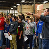 BEN MIKESELL | THE GOSHEN NEWS<br /> Chris Cappello, human resource business partner at Genesis Products, shows Goshen Middle School eighth-grade students around Plant 5 Tuesday morning in Goshen.