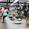 JOHN KLINE | THE GOSHEN NEWS<br /> Visitors to the Goshen Clay Artists Guild explore the various ceramic works on display during the 2018 Michiana Pottery Tour Saturday afternoon in downtown Goshen.