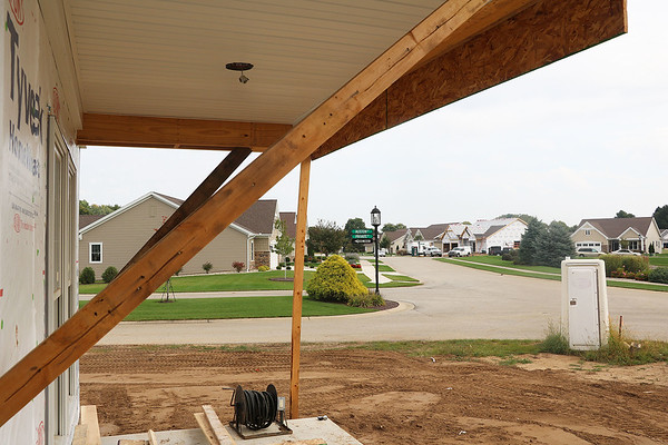 AIMEE AMBROSE | THE GOSHEN NEWS <br /> Construction work is underway on houses in the Westoria subdivision in Goshen. The houses are among several being developed in that neighborhood and other locations by Schrock Homes Inc. of Goshen.