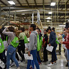 BEN MIKESELL | THE GOSHEN NEWS<br /> Goshen Middle School eighth-grade students walk through the assembly floor Tuesday morning at Genesis Products Plant 5 in Goshen during Manufacturing Day.