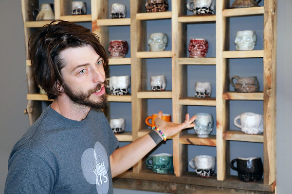 JOHN KLINE   THE GOSHEN NEWS<br /> Zach Tate, executive director of Goshen Youth Arts in downtown Goshen, discusses his ceramic work with visitors during the 2018 Michiana Pottery Tour Saturday afternoon.