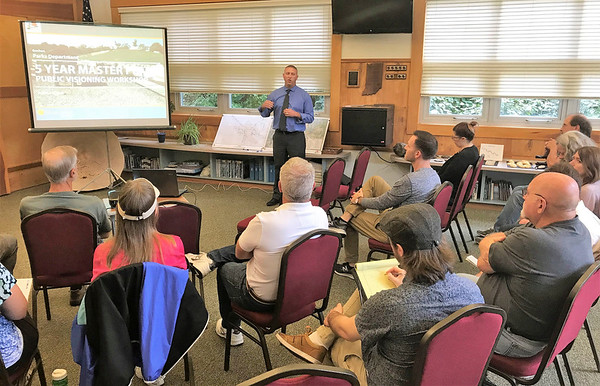 JOHN KLINE | THE GOSHEN NEWS<br /> Steve Ruby, a landscape architect with the Troyer Group, speaks to community members about the Goshen Parks and Recreation Department's planned update to its 5-Year Master Plan during a public meeting at the Rieth Interpretive Center Tuesday evening.