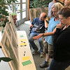JOHN KLINE | THE GOSHEN NEWS<br /> From right, Jennifer Shell, Jenny Singer and Brett Mitchell, all of Goshen, discuss things they would like to see included in the Goshen Parks and Recreation Department's upcoming 5-Year Master Plan update during a public meeting at the Rieth Interpretive Center Tuesday evening.