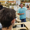 BEN MIKESELL | THE GOSHEN NEWS<br /> Dan Acker, operations manager at Genesis Products Plant 5, speaks to Goshen Middle School eighth-grade students while touring the production line Tuesday morning in Goshen.