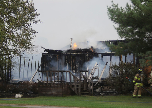 GEOFF LESAR | THE GOSHEN NEWS<br /> Goshen firefighters extinguish a fire at a home in The Willows subdivision Tuesday evening. Firefighters were dispatched at 5:10 p.m. to 214 Willows.