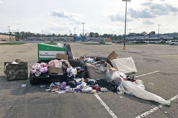 JOHN KLINE | THE GOSHEN NEWS<br /> A large pile of junk, trash and donated items can be seen accumulating at the former site of a Goodwill drop box in the Walmart parking lot on Goshen's northwest side Monday afternoon.