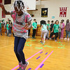 AIMEE AMBROSE | THE GOSHEN NEWS <br /> Jadelyn Anderson, a third-grader at South Side Elementary School, hopscotches her way through an obstacle course set up in the school's gym Friday. The activity was part of South Side's annual Read, Write, Move fundraiser.