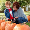 BEN MIKESELL | THE GOSHEN NEWS<br /> Rhenn Weldy, 4, left, picks out pumpkins with her grandmother Marcia Weldy, both of Goshen, Monday at the Jefferson Township Fire Department on Ind. 15. The pumpkins are obtained from a local farm and people can purchase them at any hour of the day.