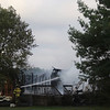 GEOFF LESAR | THE GOSHEN NEWS<br /> Goshen firefighters extinguish a fire at a home in The Willows subdivision Tuesday evening.