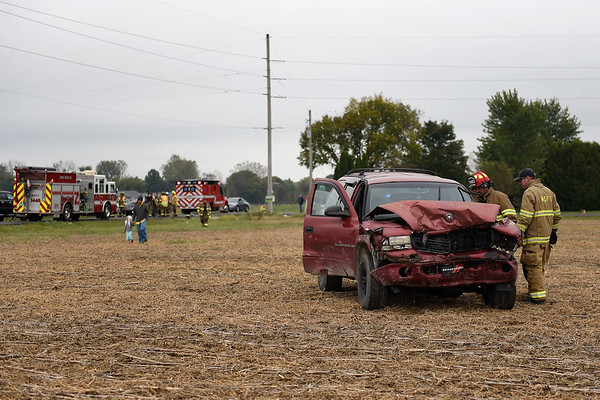 BEN MIKESELL | THE GOSHEN NEWS<br /> Millersburg-Clinton firefighters investigate a Dodge Durango involved in a wreck that occured Friday afternoon at the intersection of C.R. 40 and C.R. 43 near Millersburg. Fire chief Dean Smith said six people were involved in the accident, and three were transported to Goshen Hospital.