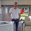 Roger Schneider | The Goshen News<br /> Dustin Johns, owner of Innovation Inc. LLC and Travel Lite RV, stands inside the company's new Evoke travel trailer. The company has entered the full-size travel trailer market with units produced in the new Travel Lite factory in Syracuse.