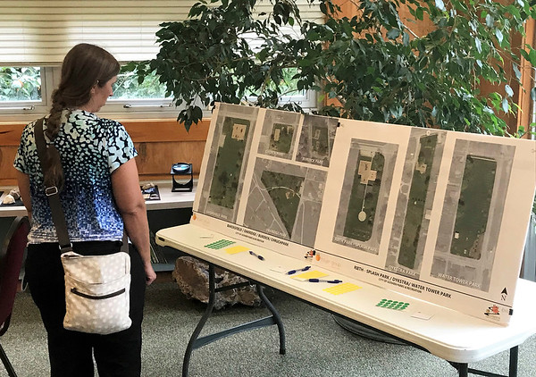 JOHN KLINE | THE GOSHEN NEWS<br /> Goshen resident Megan McClellan looks at maps of Goshen Parks and Recreation Department properties during a public meeting Tuesday at the Rieth Interpretive Center aimed at gathering community input for the planned update to the department's 5-Year Master Plan.