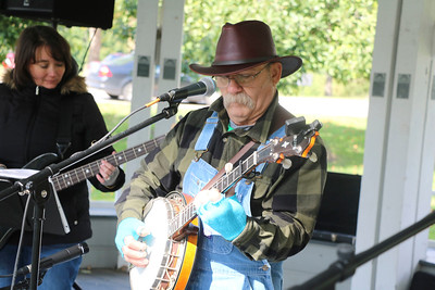 AIMEE AMBROSE | THE GOSHEN NEWS  Nelson Miller plays his banjo while performing with the Guitar-Banjo Band at the Harkless Gazeebo during the Syracuse Fall Harvest Festival at Lakeside Park Saturday.