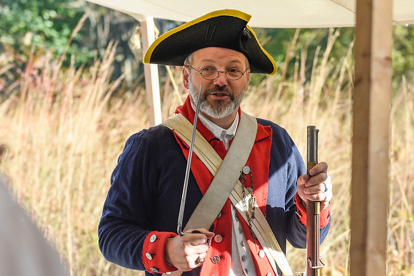 BEN MIKESELL | THE GOSHEN NEWS<br /> Gary Linley, of Elkhart, explains the difference between rifles used in the Revolutionary War Saturday morning during the Gathering at the F Medals in Benton.