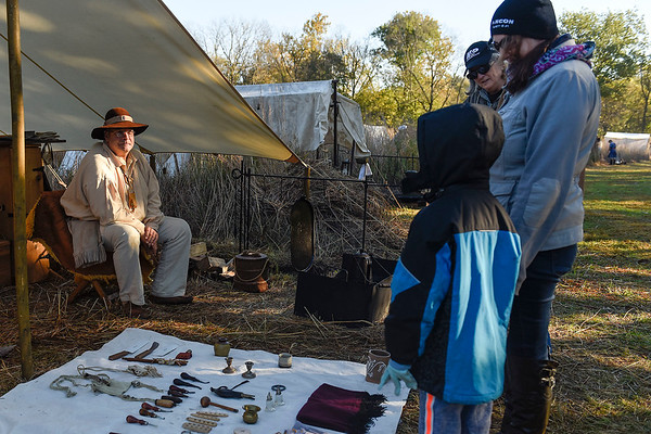BEN MIKESELL | THE GOSHEN NEWS<br /> Ty Maile, from Lawton, Michigan, displays colonial era tools and trinkets Saturday morning during the Gathering at the Five Medals in Benton.