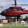 "GEOFF LESAR | THE GOSHEN NEWS<br /> <br /> Goshen City Council youth adviser Felix Perez Diener, a Goshen High School senior, and those who also ran for the seat — Ben Bontrager-Singer, Cade Richardson and Jonathon Snyder, all seniors — land on the Goshen High School soccer field  in a helicopter piloted by Randy Sharkey Wednesday afternoon. The ride was the final part of the students' day during which they were picked up by Mayor Jeremy Stutsman and taken to various city departments to meet with representatives before eating lunch together. Stutsman said the end of the day, like last year, culminated in a helicopter ride around Goshen ""so they can see it from up above."""