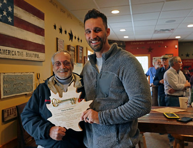 GEOFF LESAR | THE GOSHEN NEWS  Harry Scribner, left, and Goshen Mayor Jeremy Stutsman gather together with Scribner's key to the city, presented by Stutsman Wednesday afternoon at Cabin Coffee Company in Goshen.