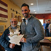 GEOFF LESAR | THE GOSHEN NEWS<br /> <br /> Harry Scribner, left, and Goshen Mayor Jeremy Stutsman gather together with Scribner's key to the city, presented by Stutsman Wednesday afternoon at Cabin Coffee Company in Goshen.