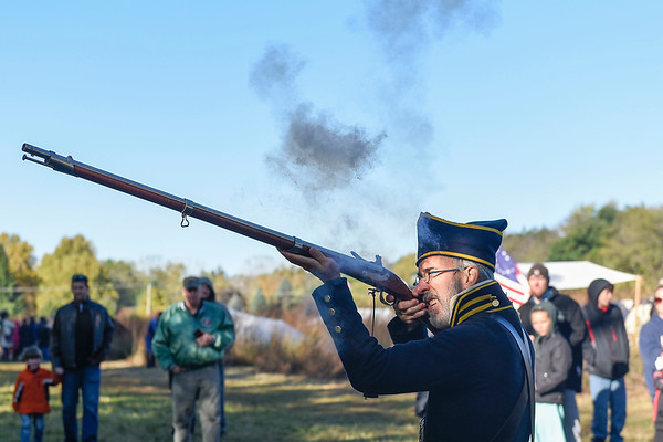 BEN MIKESELL | THE GOSHEN NEWS<br /> Ken Bloom, of Hamilton, fires off a shot from his musket Saturday morning during the Gathering at the Five Medals in Benton.