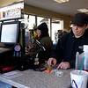"BEN MIKESELL | THE GOSHEN NEWS<br /> Neil Holmes, of Elkhart, purchases a Mega Millions lottery ticket Monday afternoon at the Lincolnway Mart at the corner of U.S. 33 and Kercher Road in Goshen. ""If I win, I win,"" Holmes said. ""I've already got a deal with four of my friends that we'd split it five ways."""