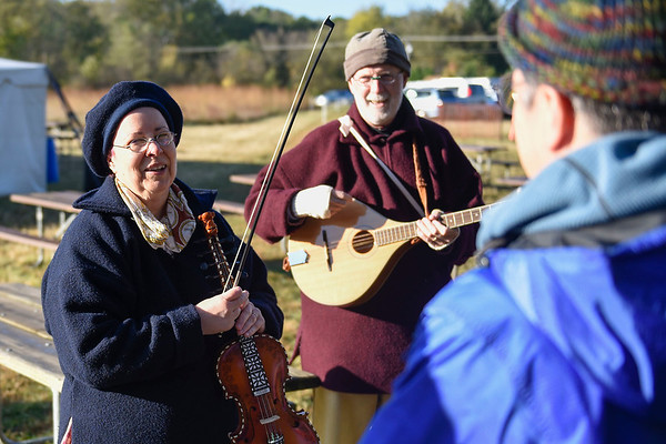 BEN MIKESELL | THE GOSHEN NEWS<br /> Perfomers Hillary Wagner and her husband Rick, from Dayton, Ohio, talk to guests Saturday morning during the Gathering at the Five Medals in Benton. The two performed each of the two mornings.
