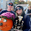 AIMEE AMBROSE | THE GOSHEN NEWS <br /> (from left) Mark Nichols and Stacey Irelan of Elkhart Plastics hold their pumpkin and trophy after winning the corporate race during the second annual Pumpkin Race in Middlebury on Saturday.